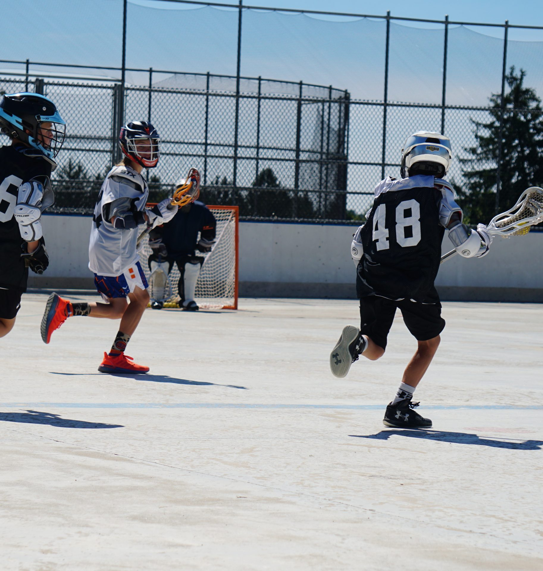box lacrosse camp scrimmage action